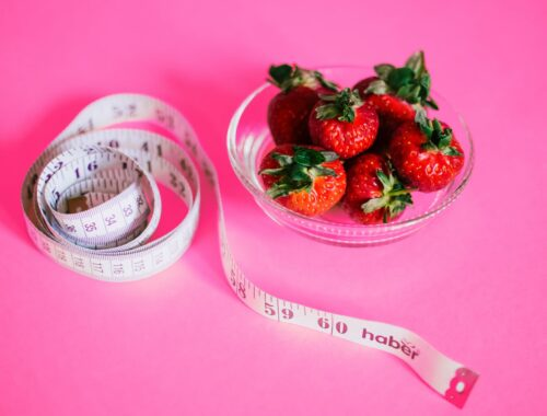 strawberries and measuring tape