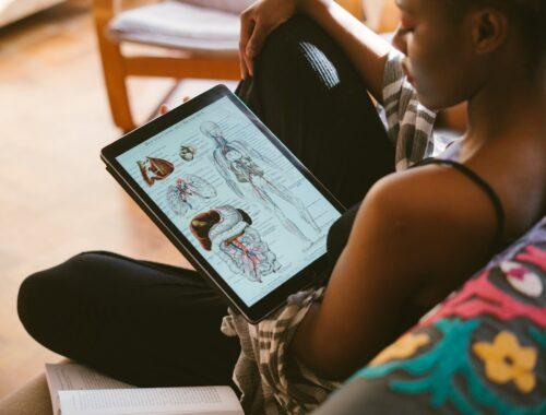photo of woman studying anatomy